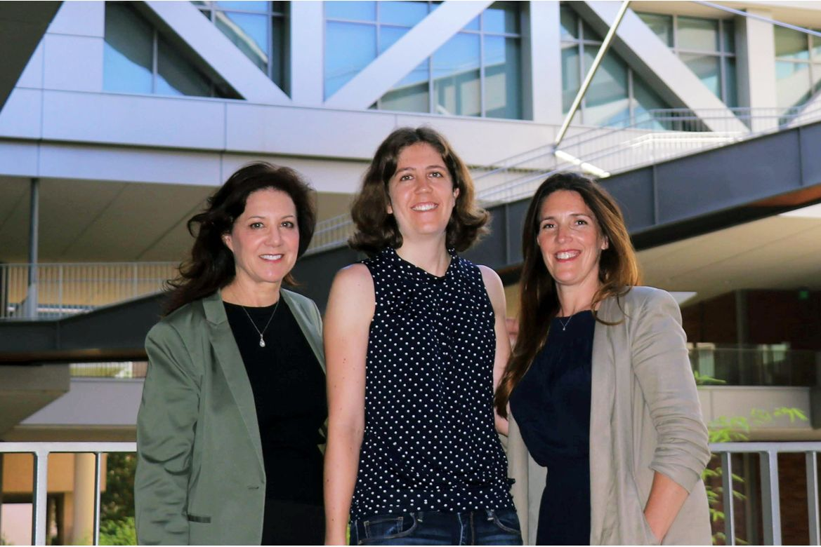 Courtney Young (center) with UCLA professors — and MyoGene Bio cofounders — Melissa Spencer and April Pyle.